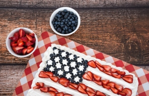 Patriotic American flag cake with blueberries and strawberries
